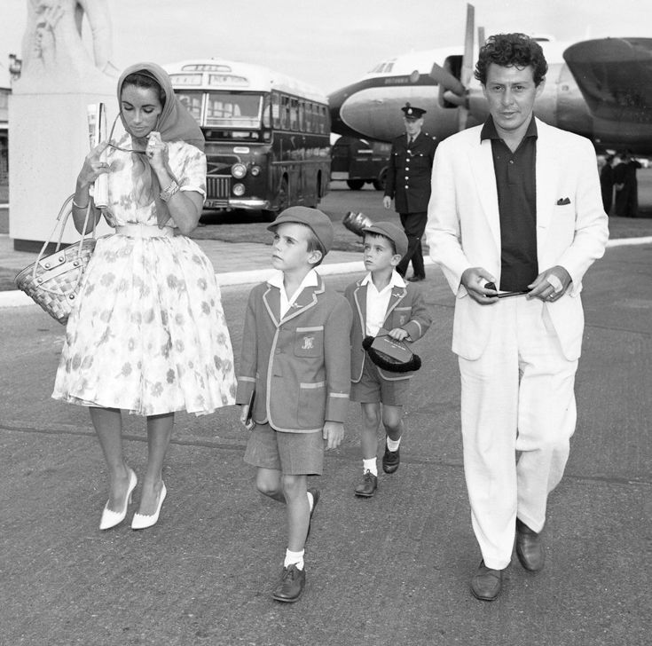 Elizabeth Taylor, Eddie Fisher & her children arriving at London Airport from Barcelona.