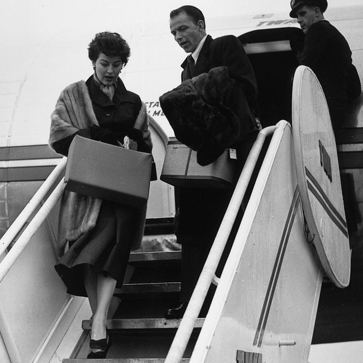 5th November 1952:  American singer Frank Sinatra and actress Ava Gardner arriving at london Airport.  (Photo by Reg Birkett/Keystone/Getty Images)