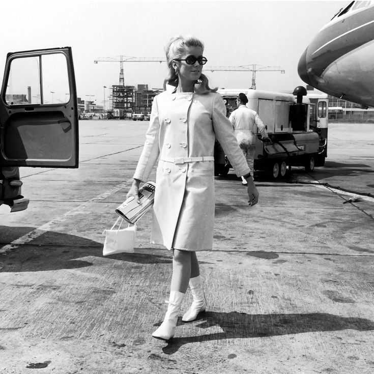 Catherine Deneuve wearing Courrèges, at London Airport in 1965.