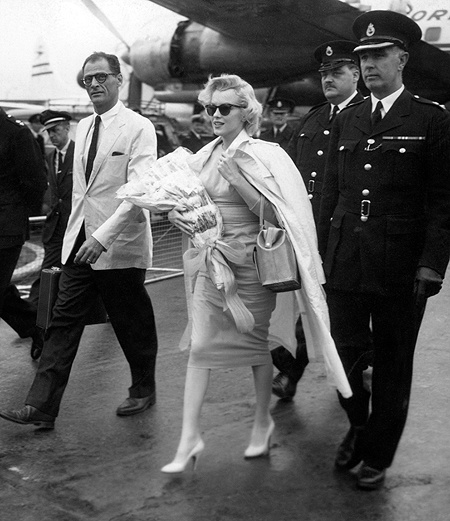 Marilyn Monroe and husband Arthur Miller touch down in London to begin work on The Prince and the Showgirl