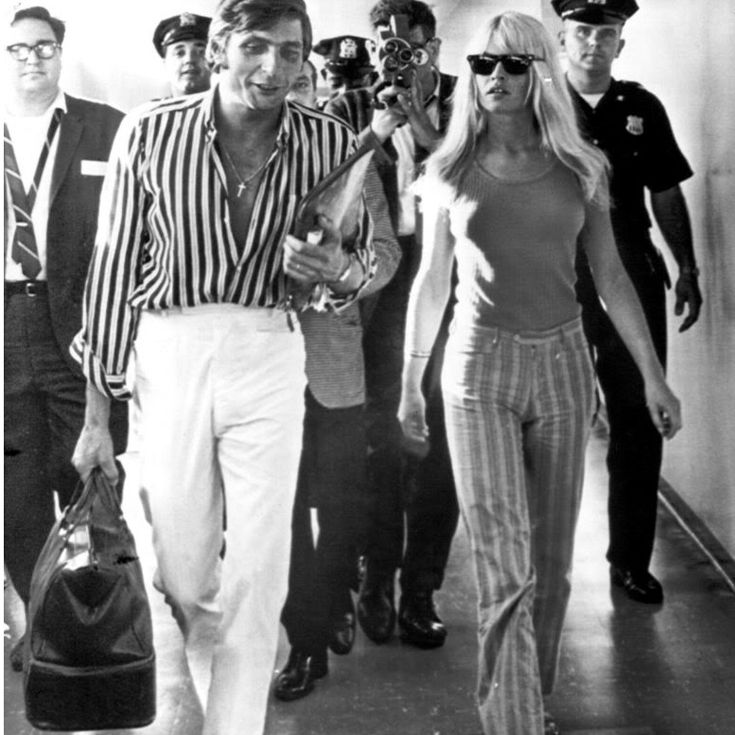 Bridget Bardot catching a connecting flight at JFK to Geneva, returning from her honeymoon in Mexico.